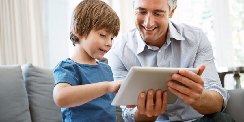 iStock 000057358240 Large kid dad laptop 845x422 - Media Use By Children: Monitor and Model