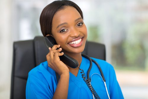 Female physician talking to patient on phone